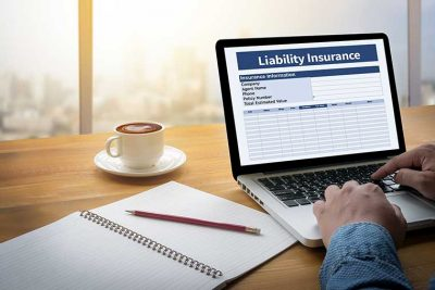 Laptop with liability insurance on screen, general liability insurance quote