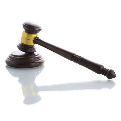 Wooden judges gavel, Umbrella Insurance